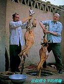 南北疆之56新疆的饢文化:03近似烤全羊烤爐.JPG