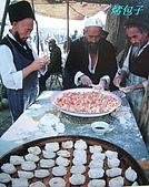 南北疆之56新疆的饢文化:06-3烤包子.JPG